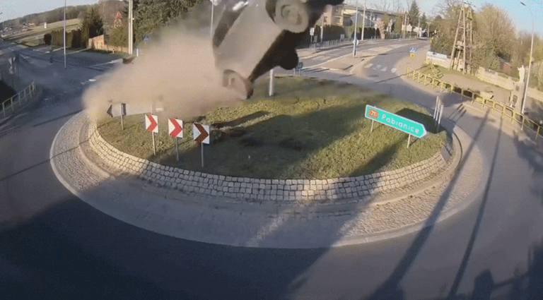 Incredible footage of a car flying through the air after hitting a roundabout